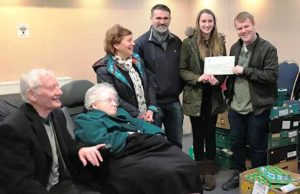 The cheque is handed over to the foodbank in Burntwood