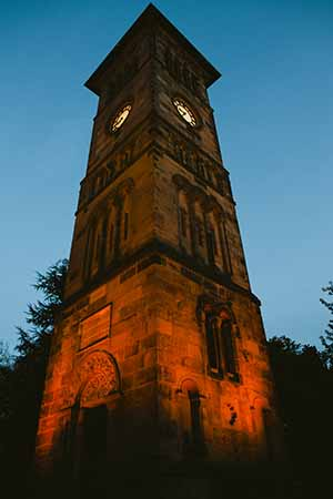Lichfield Clock Tower lit up by West Midlands Railway