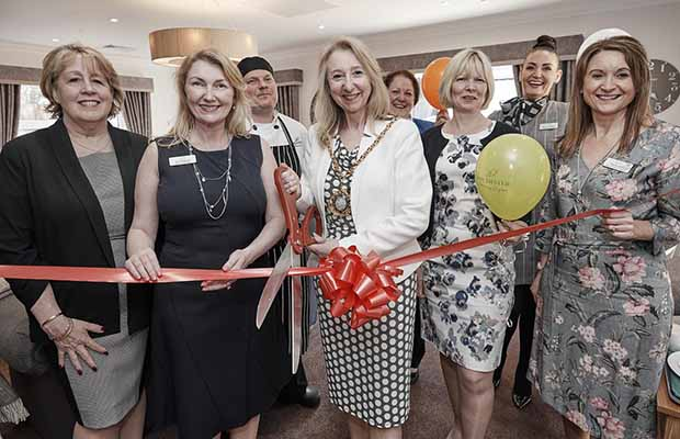 Cllr Janice Greaves cuts the ribbon at The Spires care home