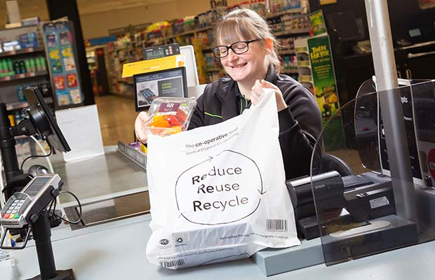 A store assistant with one of the new biodegradable bags