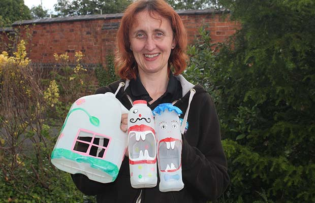 Ruth Piddington with some of the milk bottle creations