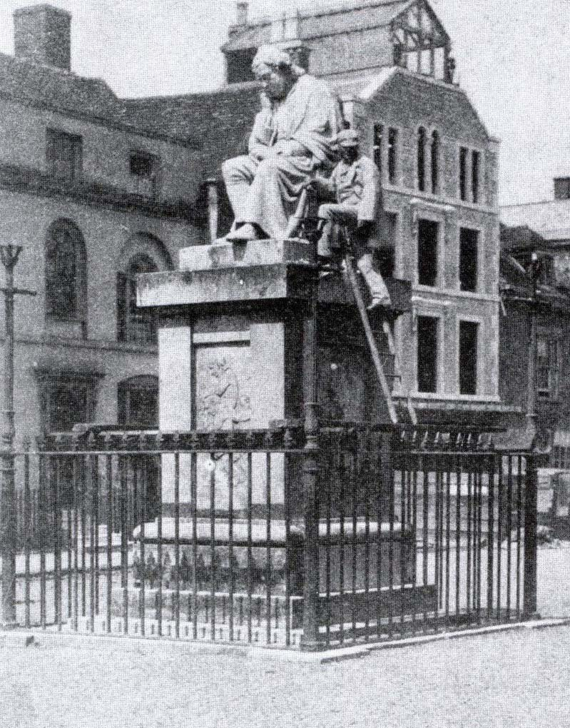 An 1859 photograph showing the original railings around the statue of Dr Johnson