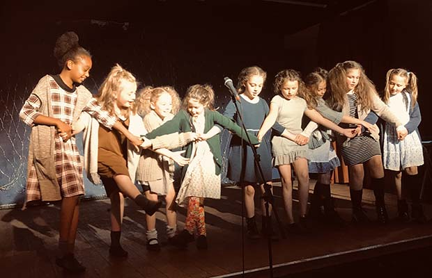 Students performing in Annie Jr