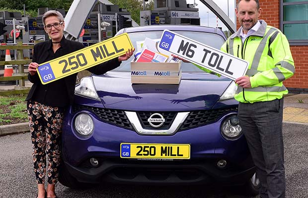 Rachael Davis celebrating with James Hodson, M6toll director