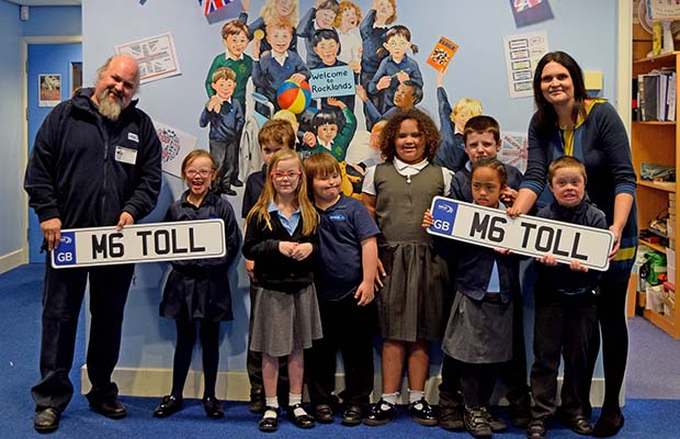 Ian Harvey from M6 Toll with teacher Claire Dryhurst and pupils from Rocklands School