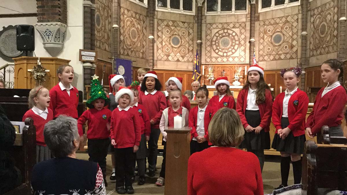 Children performing at the Christmas carol concert in St Anne's Church