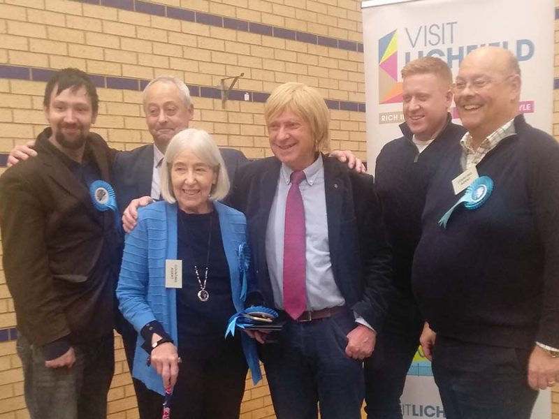Michael Fabricant (centre) celebrating his win with Conservative colleagues