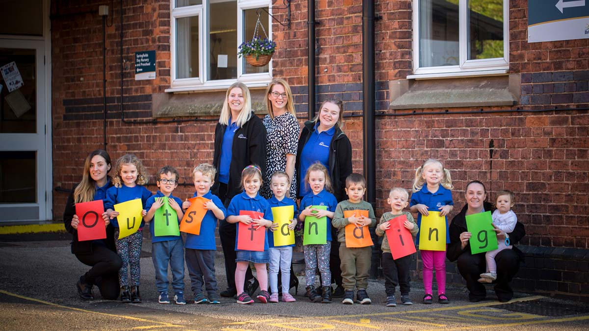 Children and staff celebrate the Ofsted report