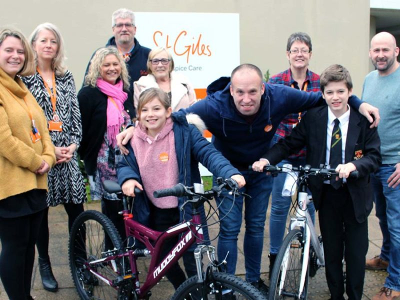 Andrew Wright (front centre) with children Naomi and Liam receiving their bikes at St Giles Hospice