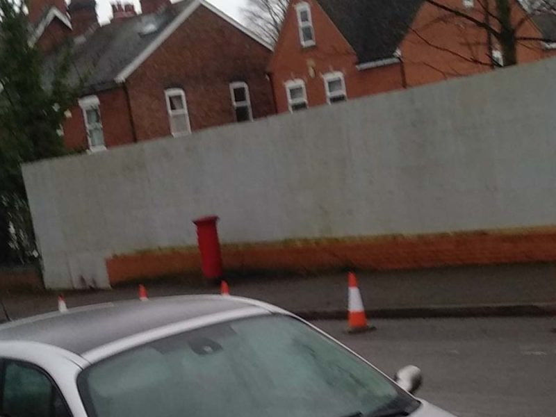 The parking bays coned off by builders