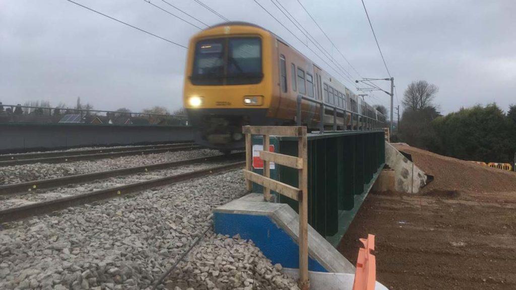 A train passing over the new bridge