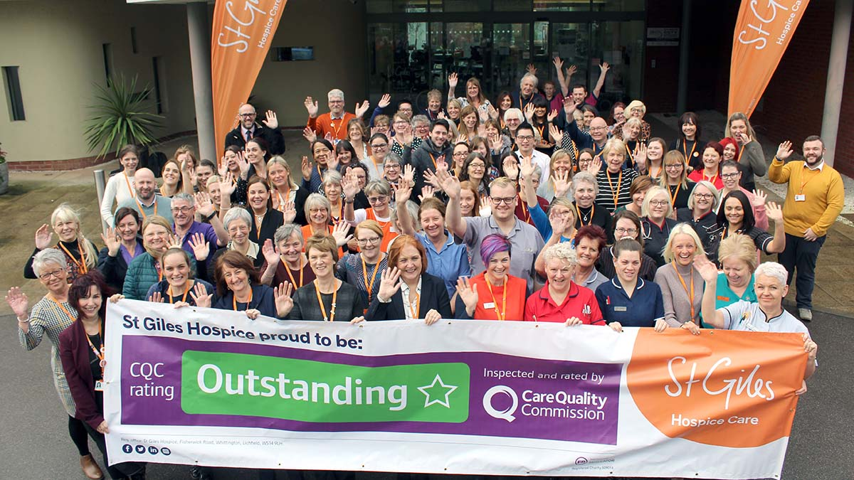 Staff and volunteers at St Giles Hospice celebrate the outcome of the CQC report