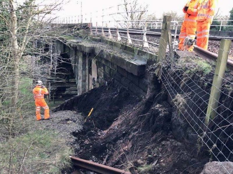 Network Rail engineers examining the land slip