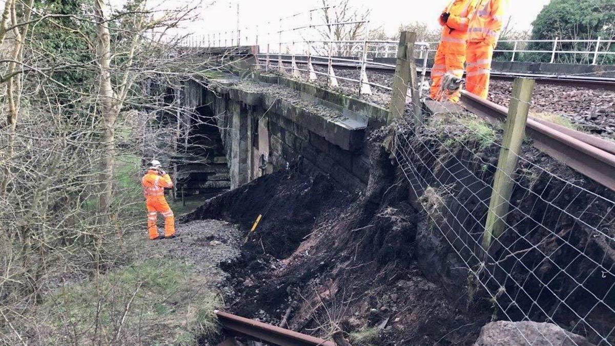 Network Rail engineers examining the land slip