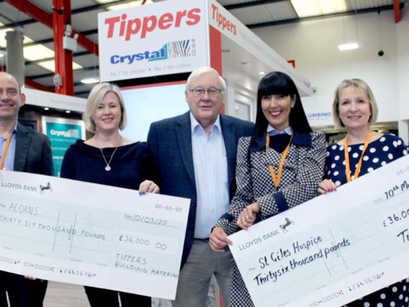 The cheques being handed over to Acorns Children's Hospice and St Giles Hospice by Tippers