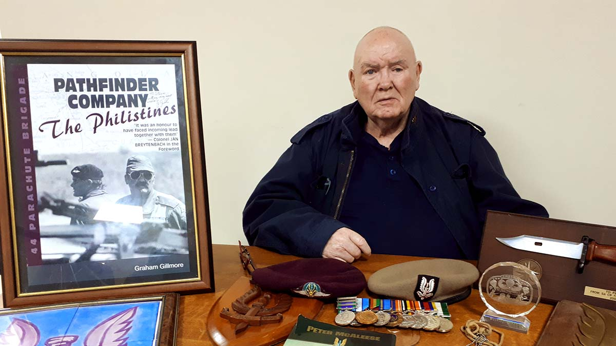 Peter McAleese with some of the items going up for auction