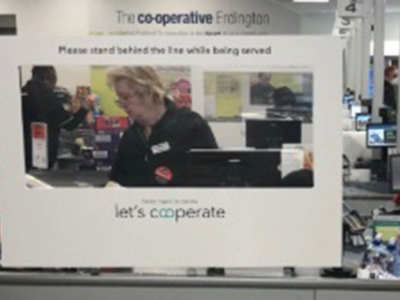 One of the protective screens being installed at Central England Co-op