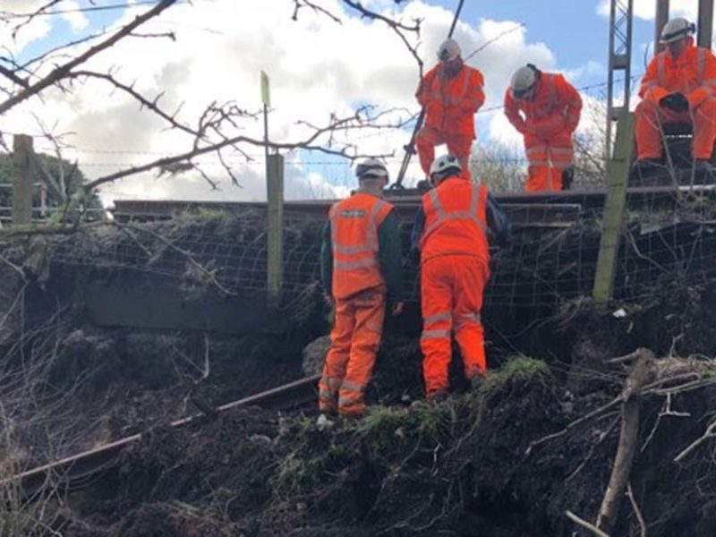 Network Rail engineers inspecting the land slip