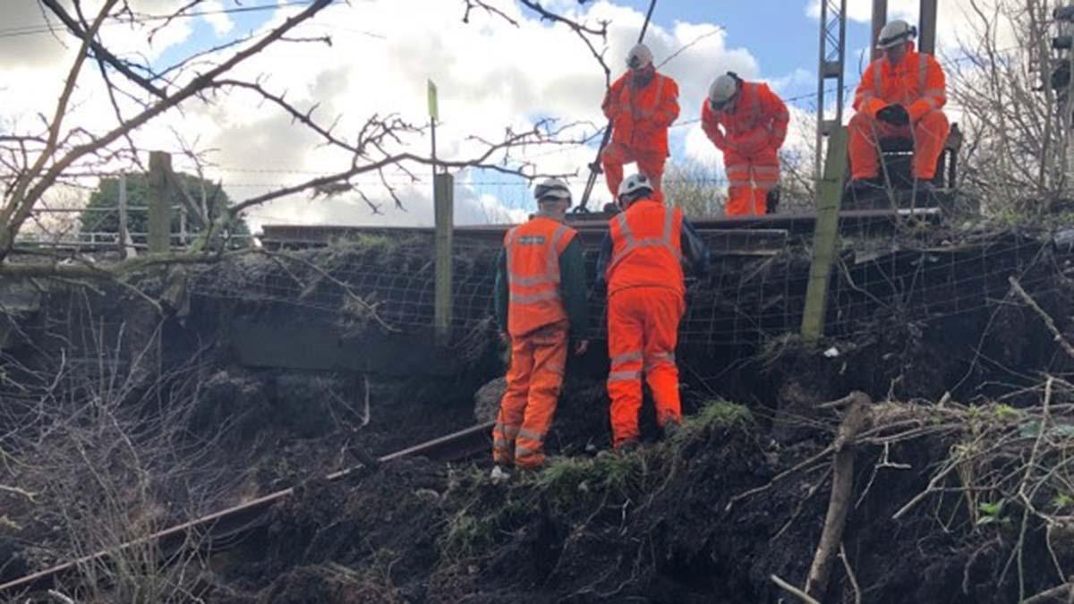 Network Rail engineers inspecting the land slip