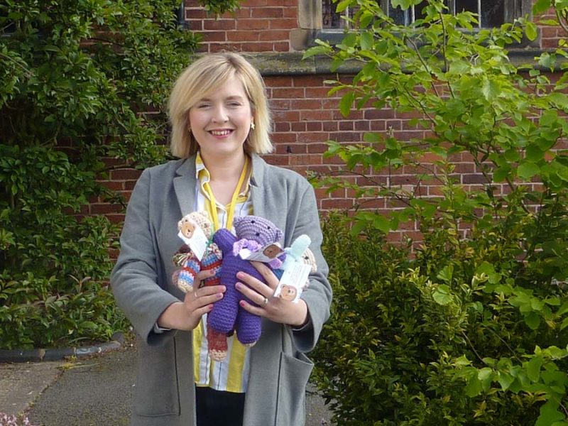 Charlotte Shutt with some of the knitted teddy bears