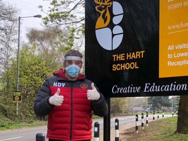 A member of the Lichfield Lions volunteer team with one of the visors from The Hart School
