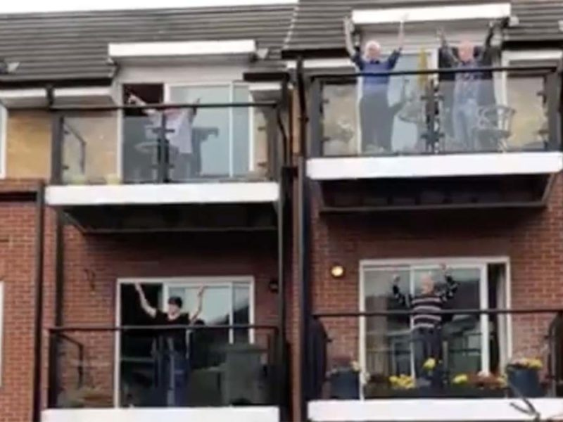 Residents exercising on their balconies at Beacon Park Retirement Village