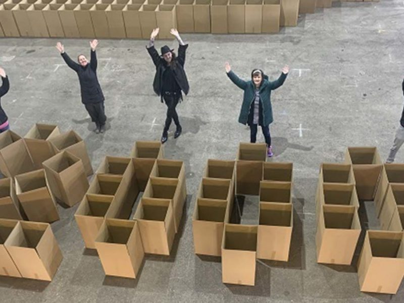 Volunteers celebrate the 2,000th food parcel being sent out