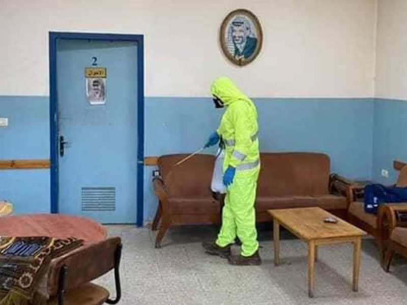 A cleaner in protective equipment. Picture: Friends of the Holy Land