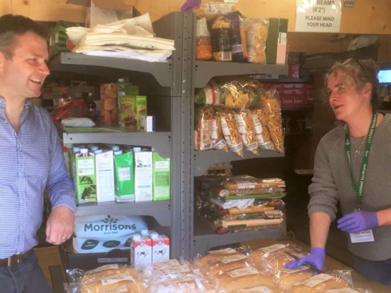 The loaves of bread being handed over