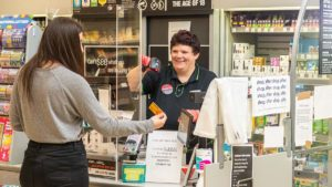 A customer being served by a member of staff at Central England Co-op in Lichfield