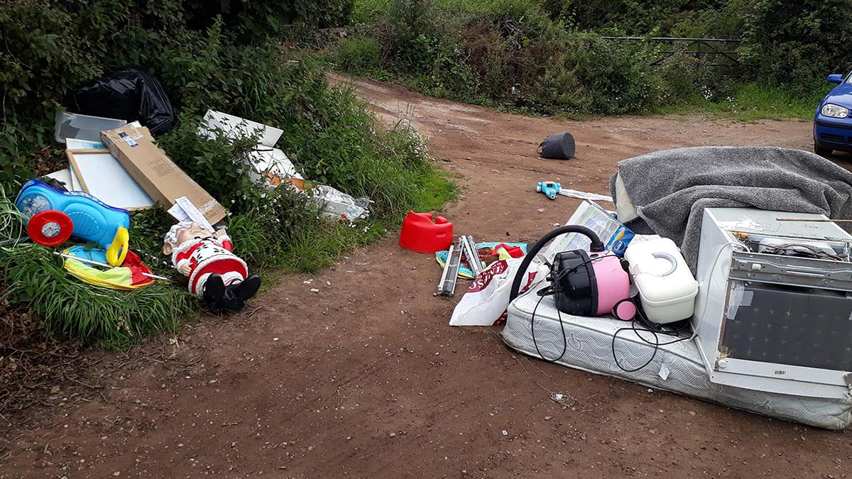 The waste left behind by fly-tippers on Wall Lane
