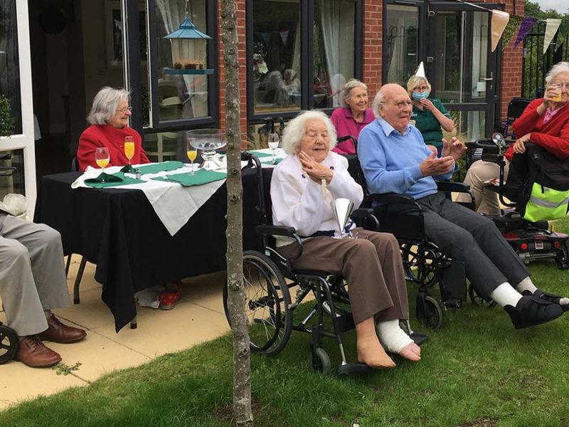 Residents enjoying the second anniversary party at The Spires care home
