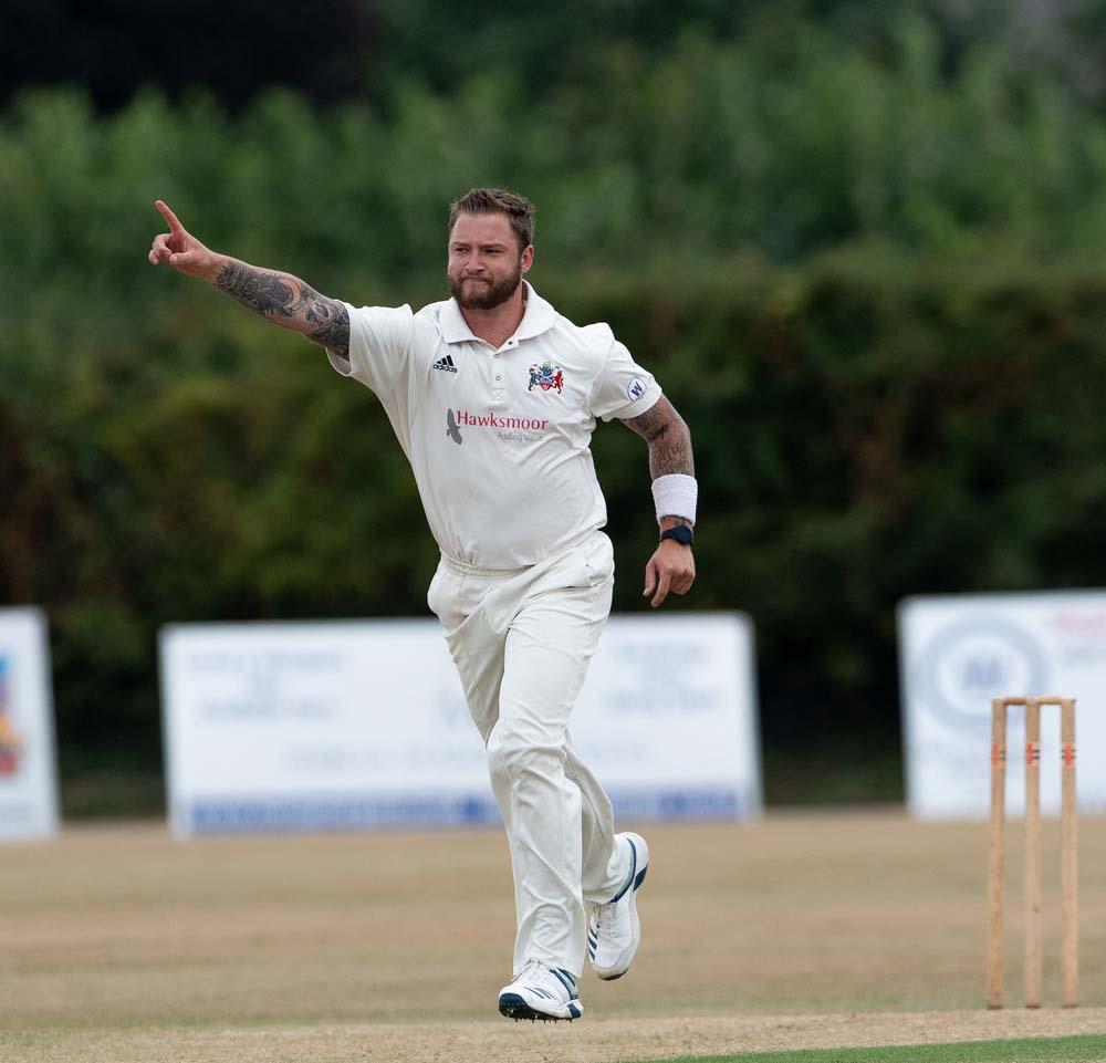 Tamworth's Josh Bowker celebrates the wicket of Lichfield's Rich Taylor-Tibbott