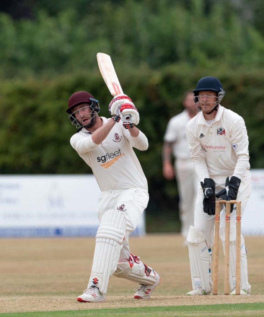 Lichfield's Stuart Fielding batting against Tamworth, watched by keeper Ben Maddox