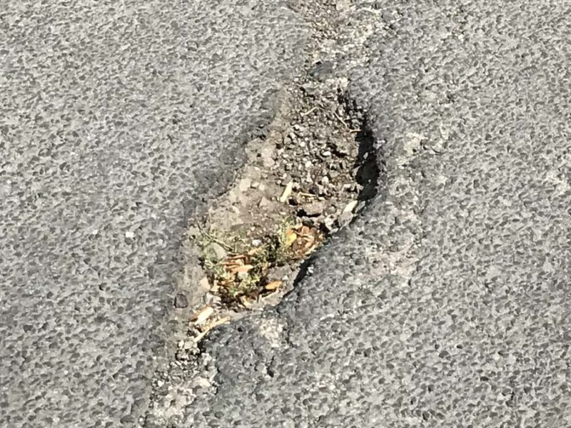 One of the potholes on Weston Road