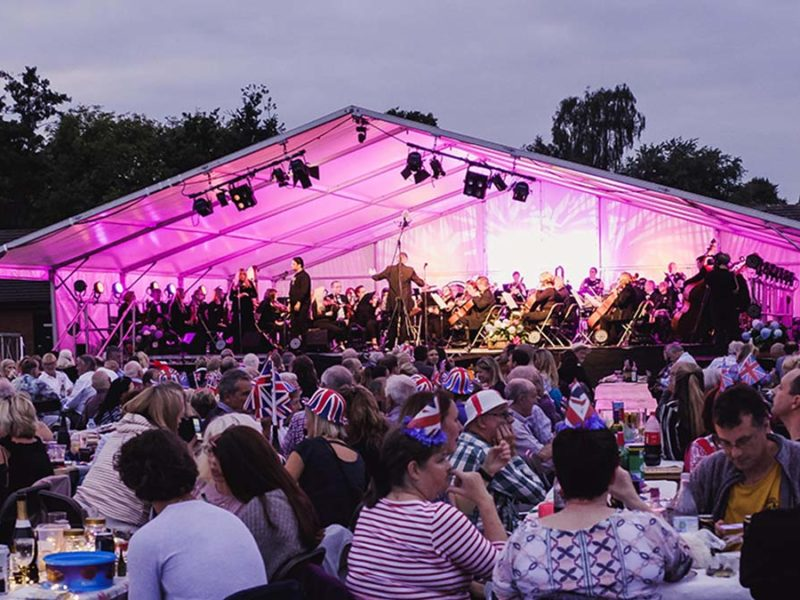 The British Police Symphony Orchestra performing at the Lichfield Proms in Beacon Park