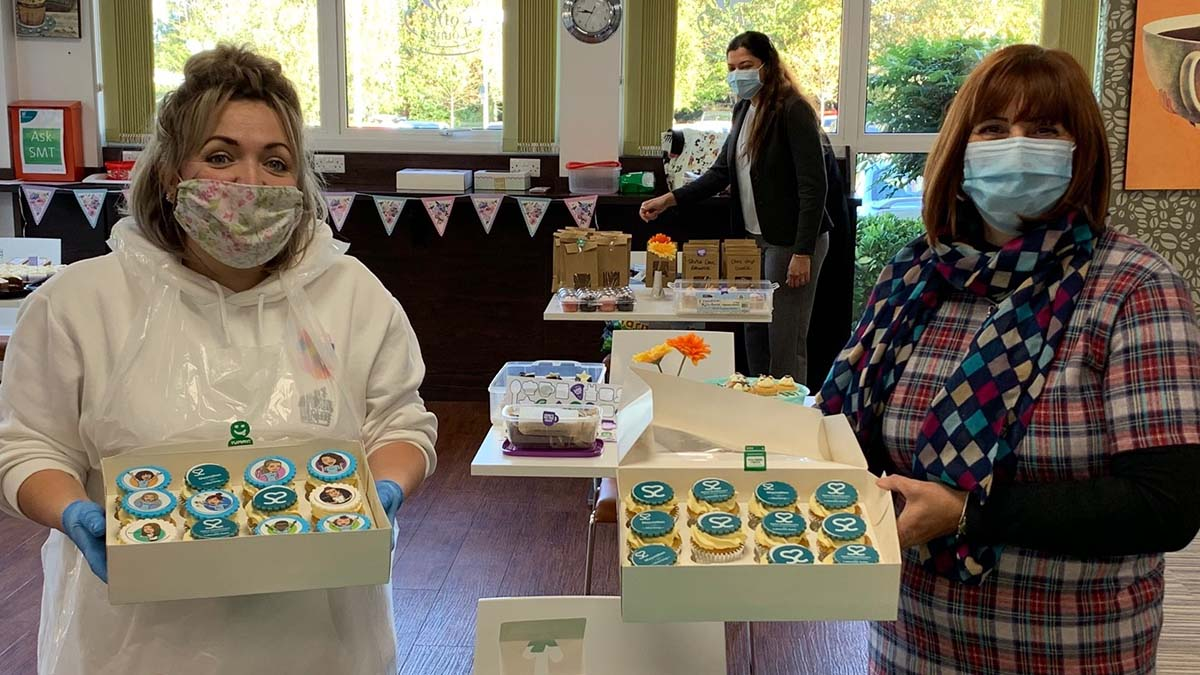 Jo-Ann Beech and Carrie Pawlowski at the cake sale