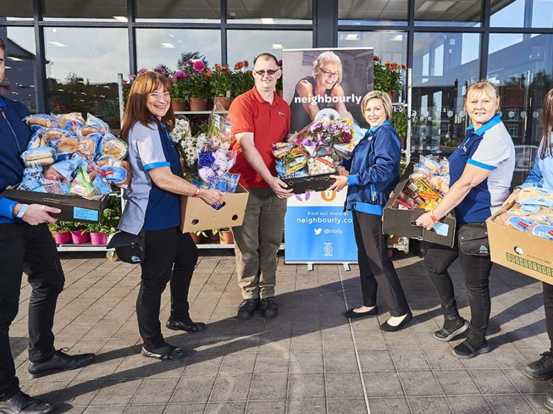 Staff with food donations outside an Aldi store