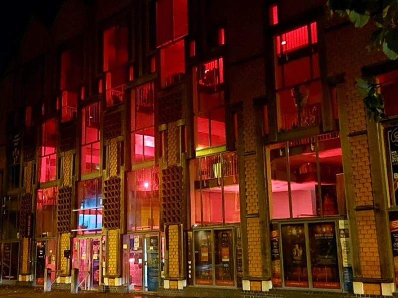 The Lichfield Garrick lit up red as part of a national day of action