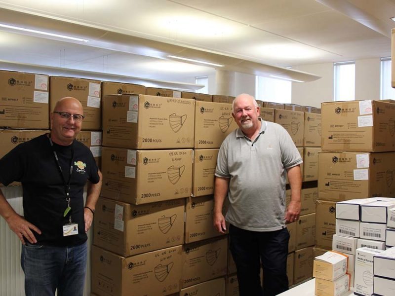 Staffordshire County Council staff John Challinor and Paul Forrester packing PPE