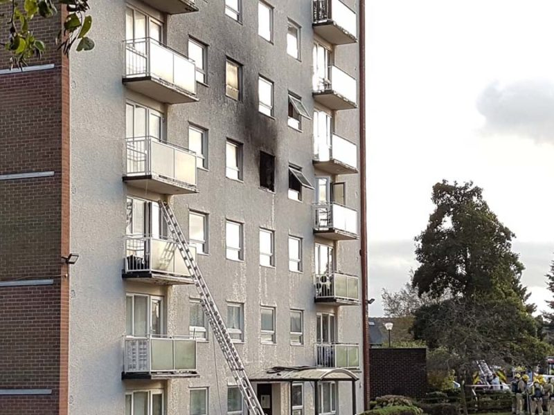 Smoke damage visible on the outside of the block of flats