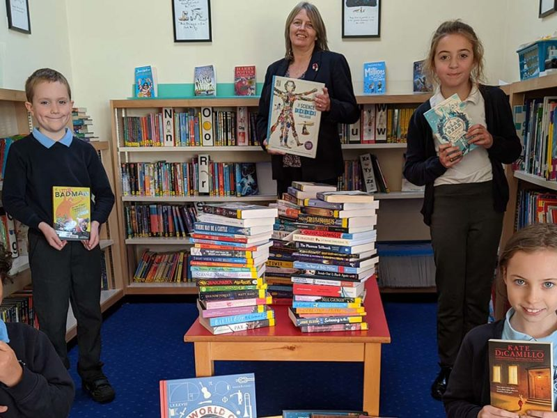 Scotch Orchard headteacher Jo Bishop with pupils celebrating the success of the virtual book drive