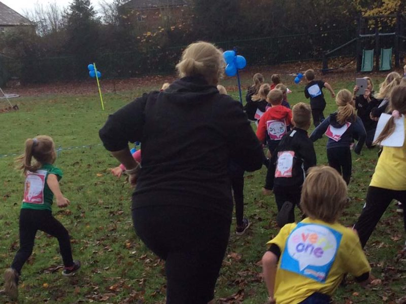 Staff and pupils taking part in the Race for Life at Greysbrooke Primary School