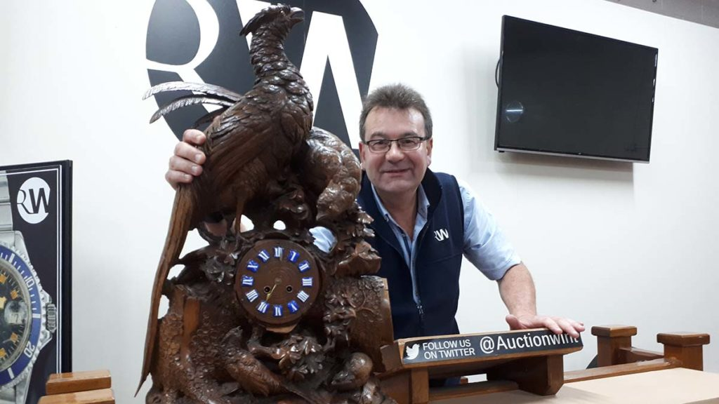 Richard Winterton with one of the clocks