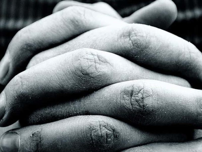 Black and white picture of clasped hands