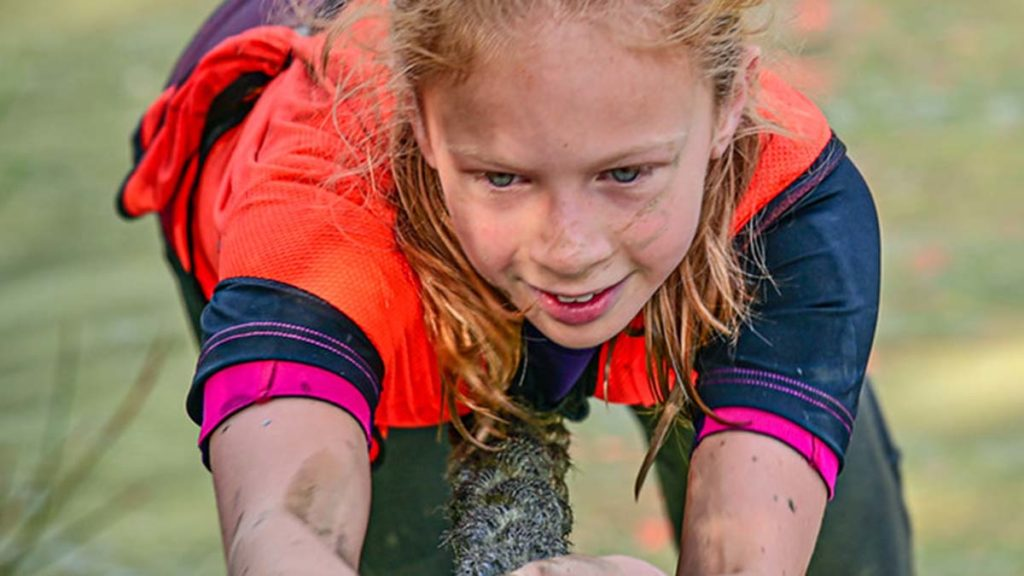 Libbie Joyce competing in an obstacle race