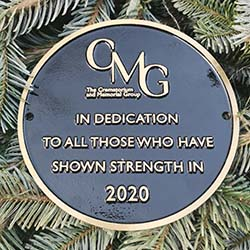 The plaque placed alongside the Christmas tree