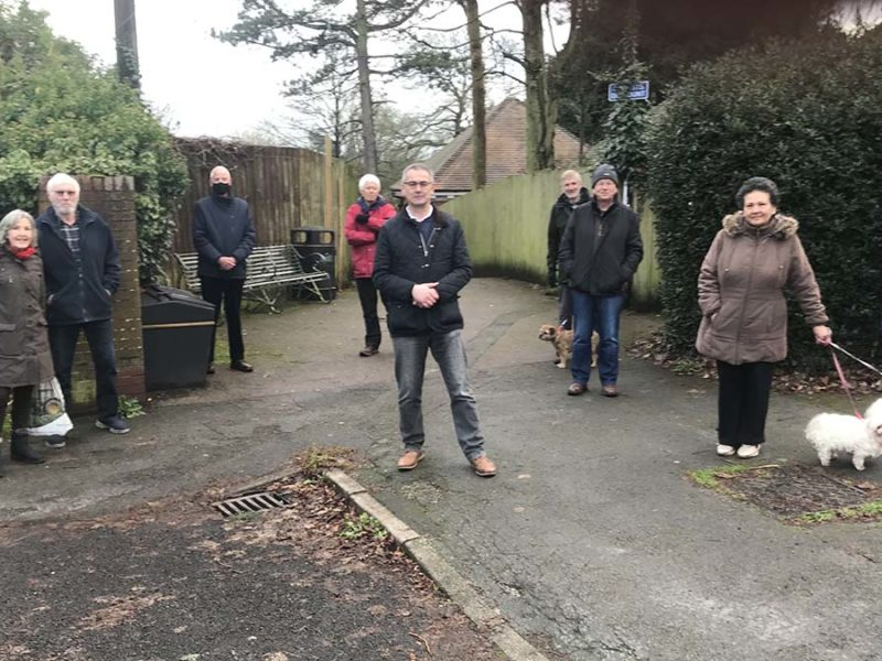 Cllr Paul Ray (centre) with residents at the entrance to the walkway
