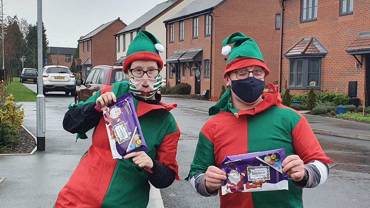 The Saxon Harriers members delivering selections boxes in Lichfield