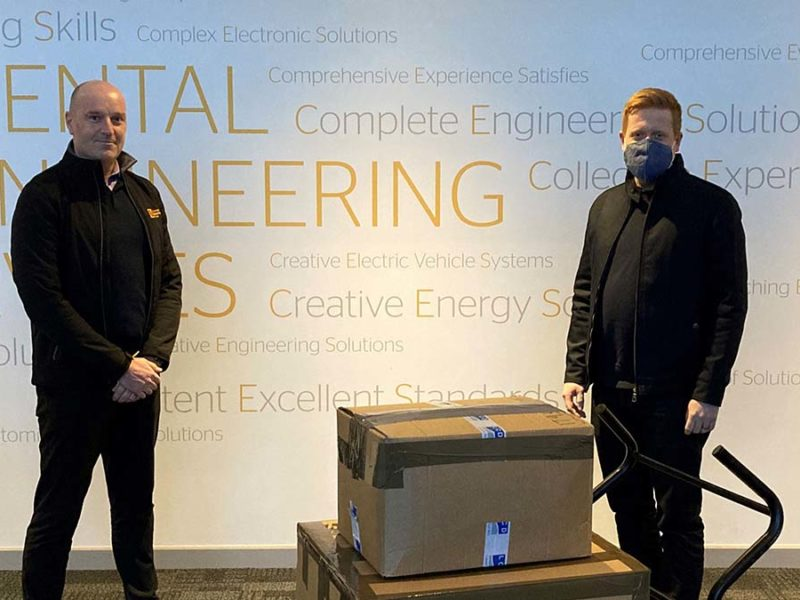 Cllr Doug Pullen (right) receiving the laptops from Continental Engineering Services